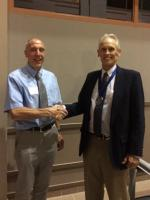Joel Coats receiving the 2017 John Doull Award from Richard Martin, President of Central States Chapter of the Society of Toxicology