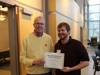 Edmund Norris, recipient of the Jim Oleson Scholarship, with Jim Oleson