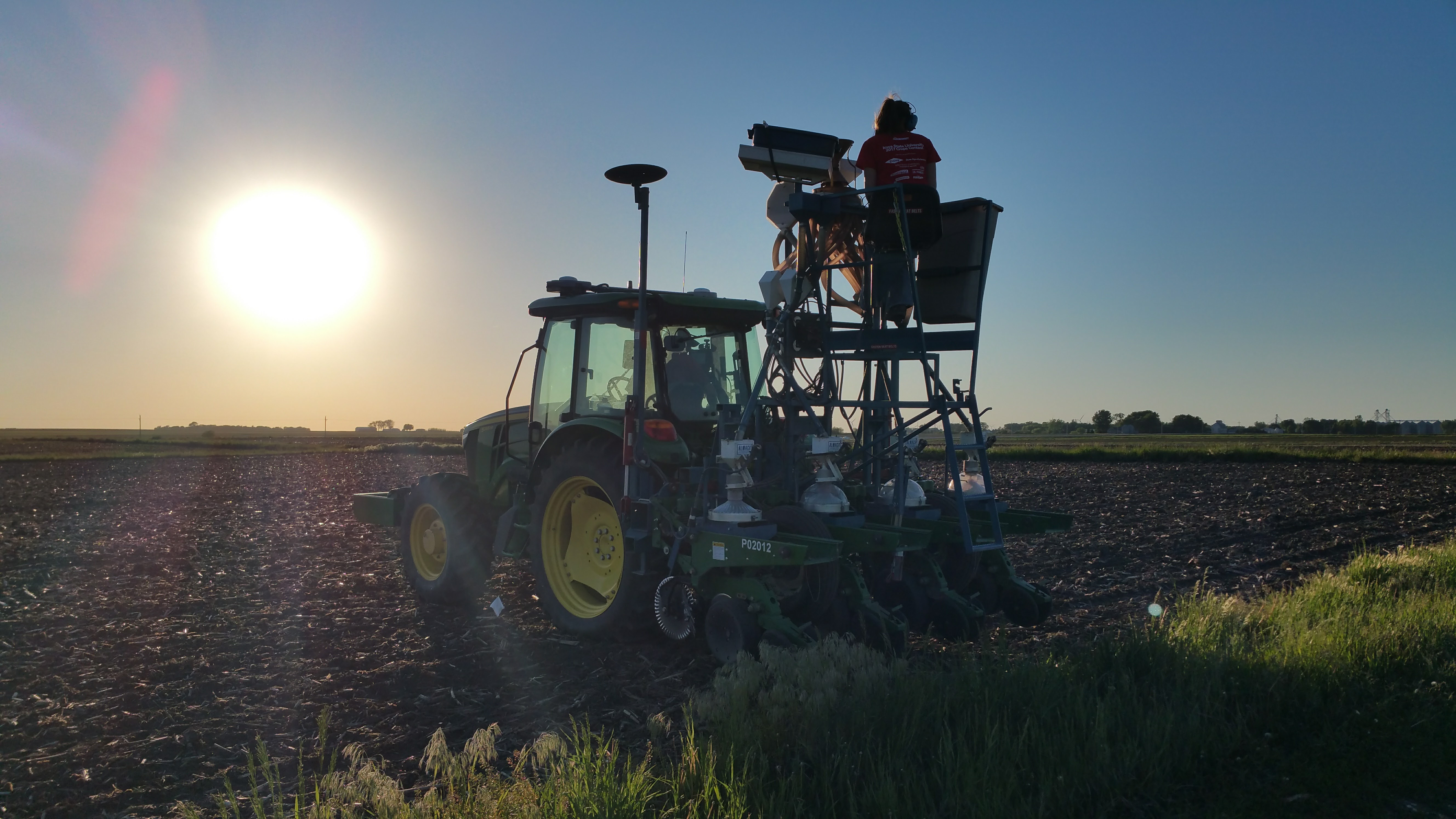 Grad student planting soybeans this week