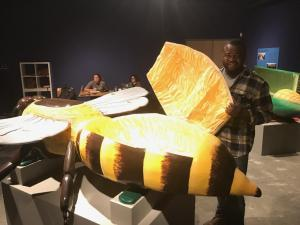 Eric Anang with honey bee coffin