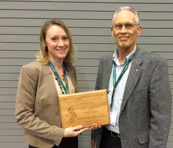 Photograph of Dr. Keri Carstens and Dr. Joel Coats at the Outstanding Regional Chapter Member award ceremony