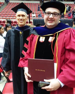 Photograph of Aaron Gross and his adviser Dr. Joel Coats at Aaron's graduation ceremony
