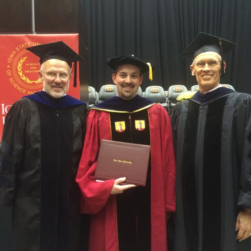 Photograph of Dr. Richard Hellmich, Vic Albright, and Dr. Joel Coats at Vic's graduation ceremony