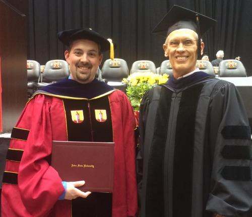 Vic Albright and Dr. Joel Coats at Vic's graduation ceremony