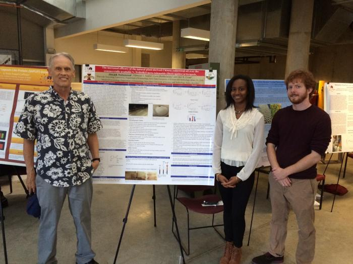 Photograph of Dr. Joel Coats, Alayjah Muhammad, and Edmund Norris at the George Washington Carver internship poster session