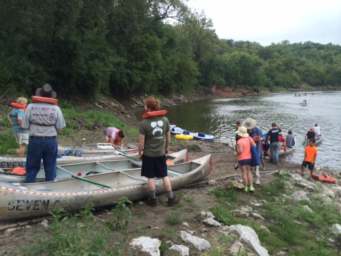 Photograph of the canoes being put into the Des Moine River at the beginning of the float trip